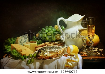 Still-life with smoked fish and cream cheese both fresh fruit and fragrant white wine - stock photo