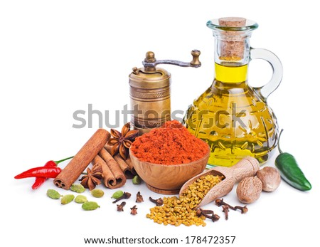 still life with spices and olive oil isolated on white background - stock photo