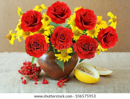 Still life with summer flowers and red roses and fruits (melon and red currants) - stock photo