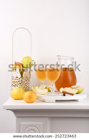Still life with tasty apple cider and fresh apples - stock photo