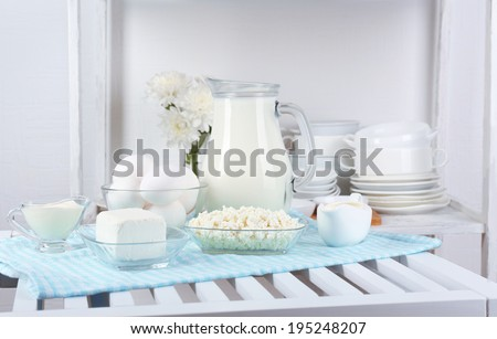 Still life with tasty dairy products on table - stock photo