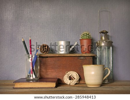 still life with tea cup and vintage objects on wooden table. - stock photo