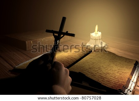 Still-life with the crucifixion on a table - stock photo