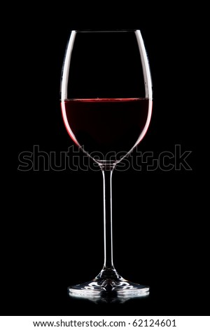 Still-life with the wine glass on black - stock photo