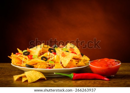 still life with tortilla chips, salsa dip and red chili pepper - stock photo