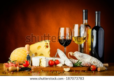 still life with traditional cheese, sausages food and wine - stock photo