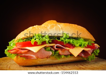 still life with traditional homemade deli sub sandwich - stock photo