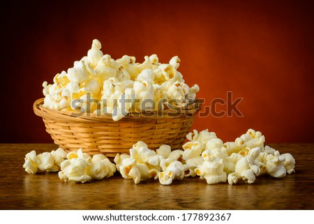 still life with traditional homemade popcorn in a basket - stock photo
