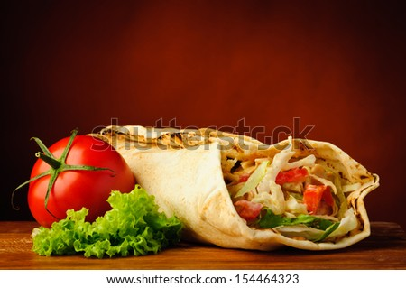 still life with traditional homemade shawarma and vegetables - stock photo