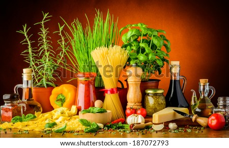 still life with traditional italian pasta ingredients, herbs and spices - stock photo