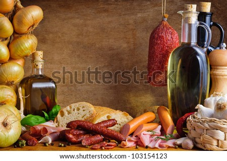 Still life with traditional meat and sausages - stock photo
