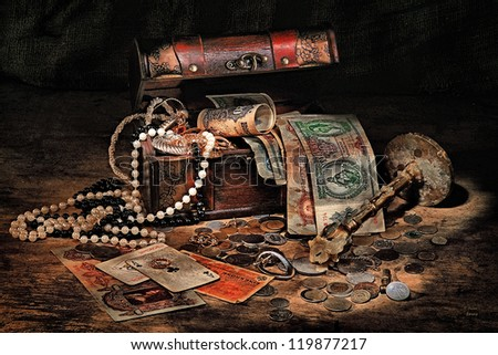 Still life with treasures, cards, candlestick on a dark background - stock photo
