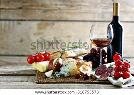 Still life with various types of Italian food and wine - stock photo