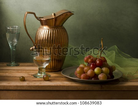 Still life with vintage pitcher and grapes - stock photo