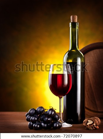 Still life with wine bottle, glass and oak barrels. - stock photo