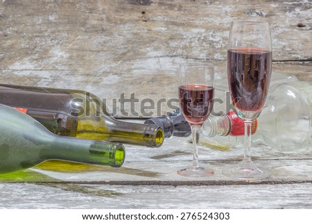 Still life with wine  bottle,   on wood table background - stock photo