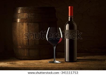 Still life with wine bottles, glasses and oak barrels  vintage - stock photo