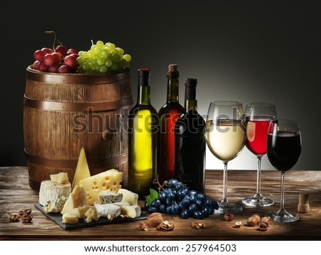 Still-life with wine, cheeses and fruits. - stock photo