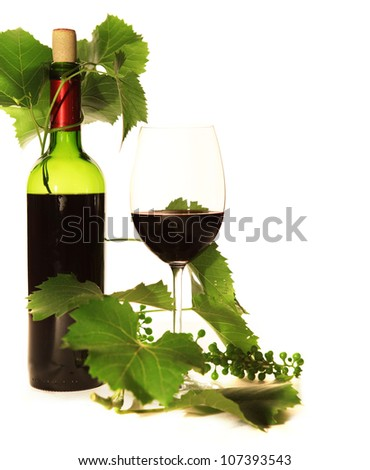 Still life with wine goblet in warm tones light - stock photo