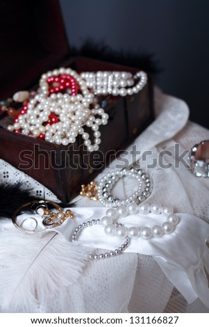 Still life with wooden treasure chest with pearl necklaces. - stock photo