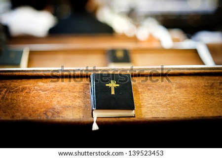 Still photo of bible put on wooden desk in church - stock photo