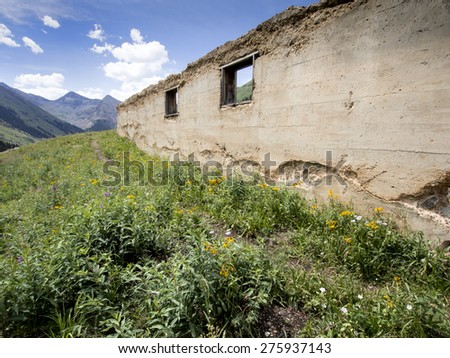 Still Standing - a decay building near San Juan mountain area - stock photo