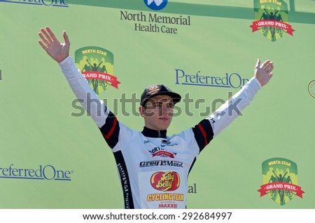STILLWATER, MN/USA - JUNE 21, 2015: Pro cyclist Nicolae Tanovitchii wins Best Young Rider jersey at prestigious 2015 North Star Grand Prix pro cycling event in Stillwater. - stock photo
