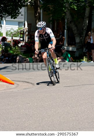 STILLWATER, MN/USA - JUNE 21, 2015: Second-place finisher Ben Hill on course at Stillwater Criterium or stage six of prestigious 2015 North Star Grand Prix pro cycling event in Stillwater. - stock photo