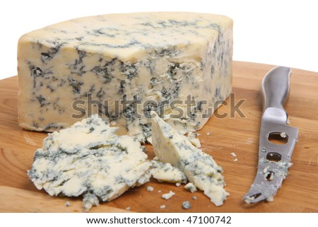 Stilton cheese on cheeseboard with knife. - stock photo