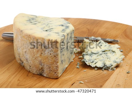 Stilton cheese with cheese knife - stock photo