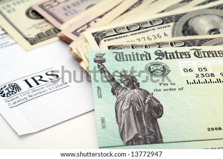 Stimulus economic tax return check and USA currency - stock photo