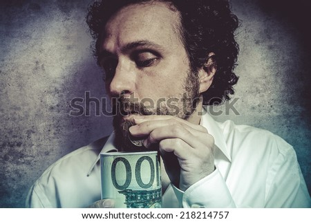 stingy businessman, saving money, man in white shirt with funny expressions - stock photo