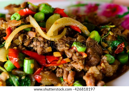 Stir basil meat tastes very spicy, but also very tasty - stock photo