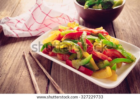 Stir fired mix color of sweet peppers on old wood, Vegetarian food  - stock photo