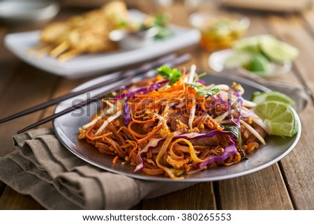 stir fried beef pad thai with color garnish and chopsticks - stock photo