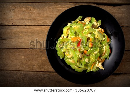 Stir Fried Bitter Gourd with Egg, chili and shredded carrot - stock photo