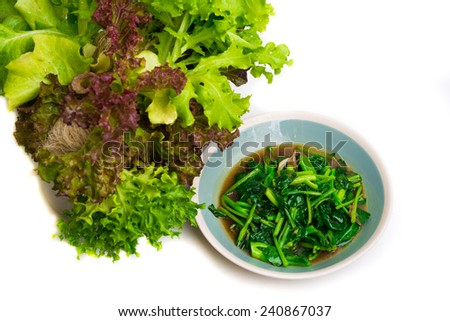 Stir fried kale vegetables isloated on white - stock photo