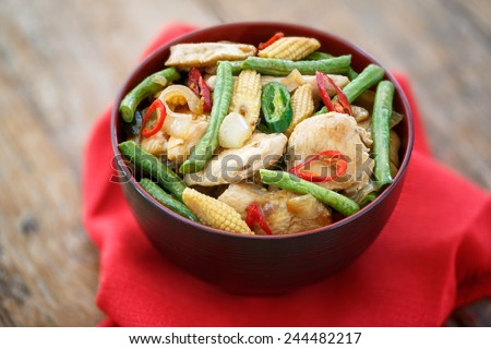 Stir fried minced chicken with vegetables, Thailand - stock photo