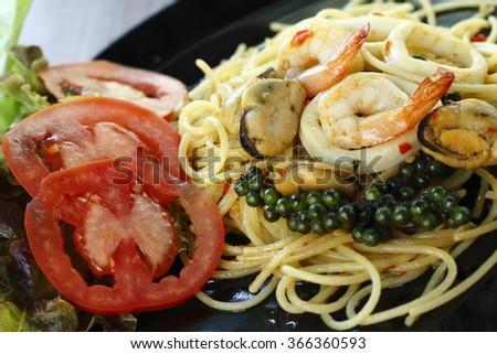 stir-fried spicy spaghetti with seafood. thai style  stir-fried spicy spaghetti with seafood. stir-fried spicy pasta with seafood. thai style  stir-fried spicy pasta with seafood. - stock photo