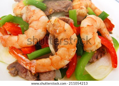 Stir fried vegetables and shrimp, beef on white  - stock photo