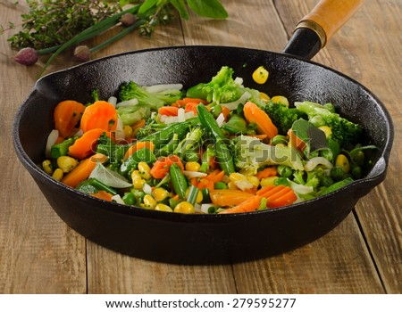 Stir fried vegetables in  a iron skillet . Selective focus - stock photo