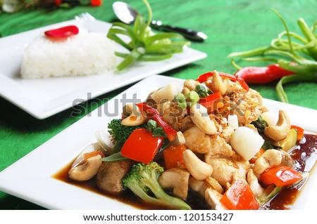 Stir fry chicken cashew nuts with jasmine rice backround - stock photo