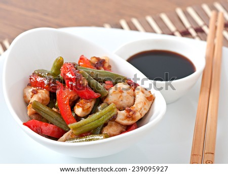 Stir fry chicken with sweet peppers and green beans - stock photo