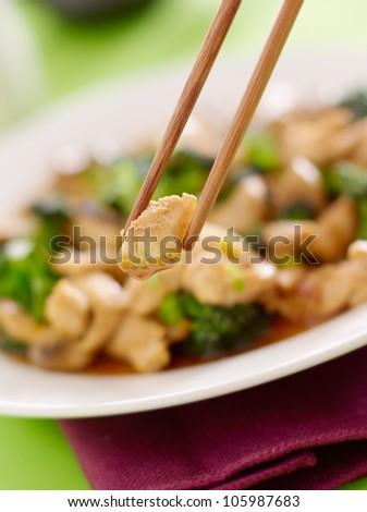 stir fry chopstick closeup eating chicken and broccoli - stock photo