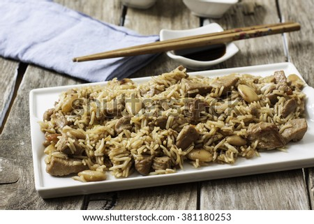 stir fry rice whit chicken and almonds on oyster sauce  - stock photo