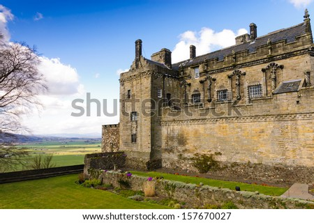 Stirling Castle from the gardens and over the ramparts to the countryside below - stock photo