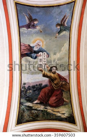STITAR, CROATIA - AUGUST 27: God gives Moses the Ten Commandments, fresco in the church of Saint Matthew in Stitar, Croatia on August 27, 2015 - stock photo