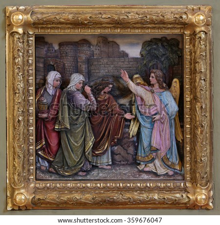 STITAR, CROATIA - AUGUST 27: Mary Magdalene and women at the empty tomb of Jesus on day of Resurrection, relief on the baptismal font, church of Saint Matthew in Stitar, Croatia on August 27, 2015 - stock photo