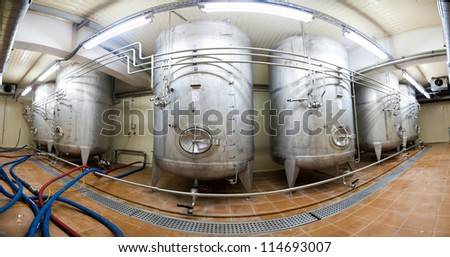 Stitched Panorama Large dural tank sludge beer before bottling plant - stock photo