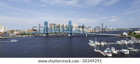 stitched panoramic of the blue bridge spanning the St. John's River in downtown Jacksonville, Florida - stock photo